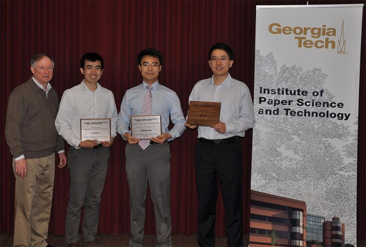 Norman Marsolan with award recipients Lester Li, Qining Sun, and Jie Wu